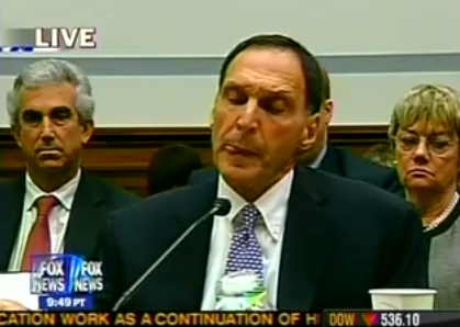 George Sard, Chesapeake's new PR man, is pictured at left, over Lehman Brothers CEO Dick Fuld's shoulder.