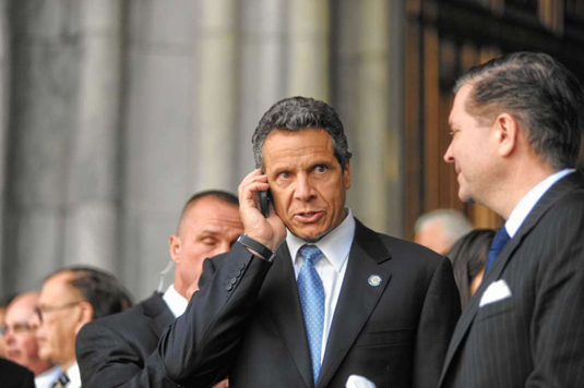 Cuomo on his Blackberry.